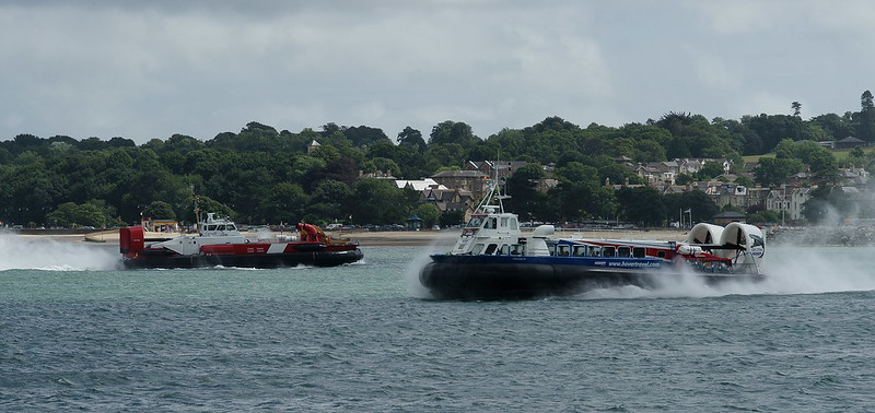 Two hovercrafts passing