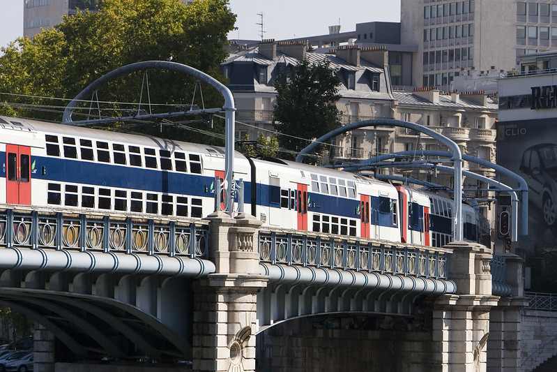 Pont Rouelle between the Allée des Cygnes and the left bank of the Seine, carrying an RER C train