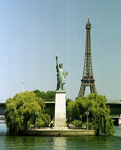 The Statue of Liberty on the Île aux Cygnes, with the Eiffel Tower in the background